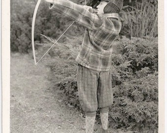 Old Photo Boy wearing Plaid Hat Coat Knickers Argyle Socks Holding Bow and Arrow 1930s Photograph snapshot vintage