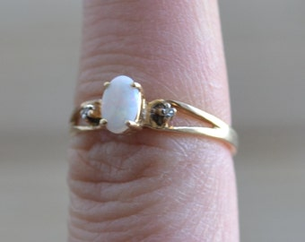Beautiful antique style vintage 10k gold opal ring with diamond chips