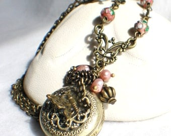 Butterfly pocket watch pendant, bronze butterfly with freshwater pearls charms and bronze accents.