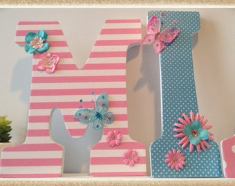 Pink Nursery. Butterfly Theme. Butterflies. Girls Nursery or Bedroom Wall Letters. Paisley. Stripes. Pink. Blue. White. Flowers.