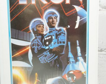 Tron VHS Tape. 1980's Science Fiction Movies. The Grid. Light Cycles. Jeff Bridges. Bruce Boxleitner.  Walt Disney Home Video. Movie Decor.