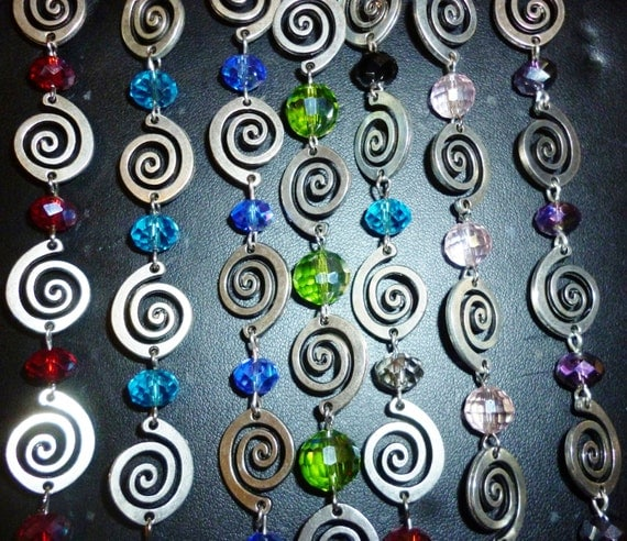 Faceted metallic spiral and glass bead bracelet