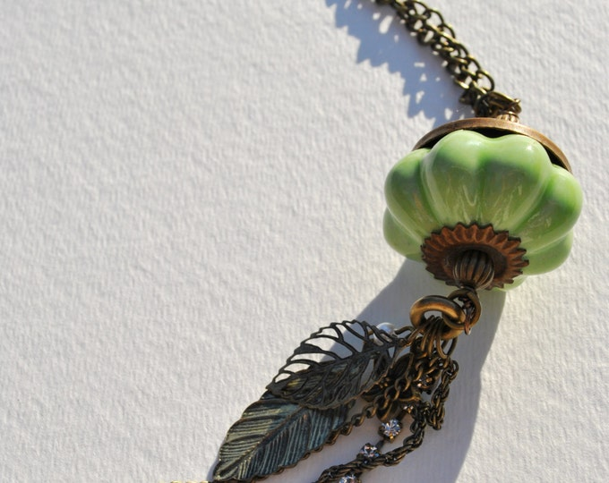 Soft Green pumpkin shape pendant necklace with brass and leaf dangles, fall necklace