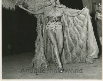 Woman circus performer with feather fan antique photo