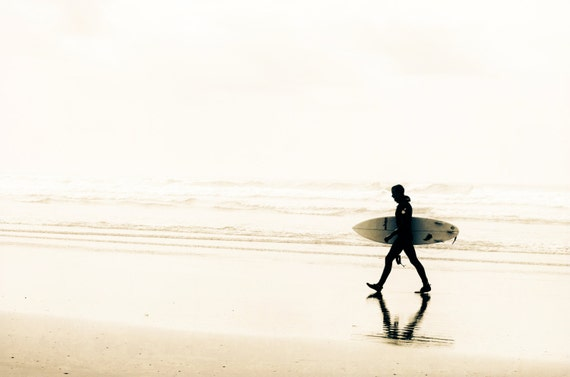 Surfer with Surfboard at Pacific Beach. Travel Photography. Monochrome. Sepia Print by OneFrameStories.