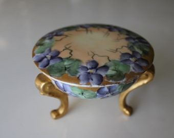 Hand Painted porcelain footed box with lid.