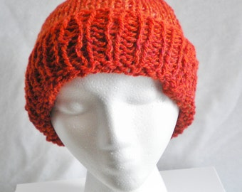 Soft, knit hat, rust/red color