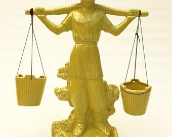 Chinese waterbearer statue