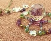 Solar powered spinning light, purple and green, magic spell, light & rainbow maker, crystal suncatcher, pretty visualizer, spiritual, starry