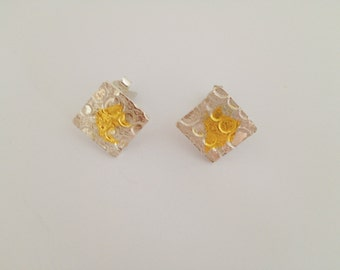 Handmade silver studs with 99,9 % finegold parts