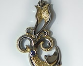 Kraken necklace , silver, gold and sapphire giant squid pendant.