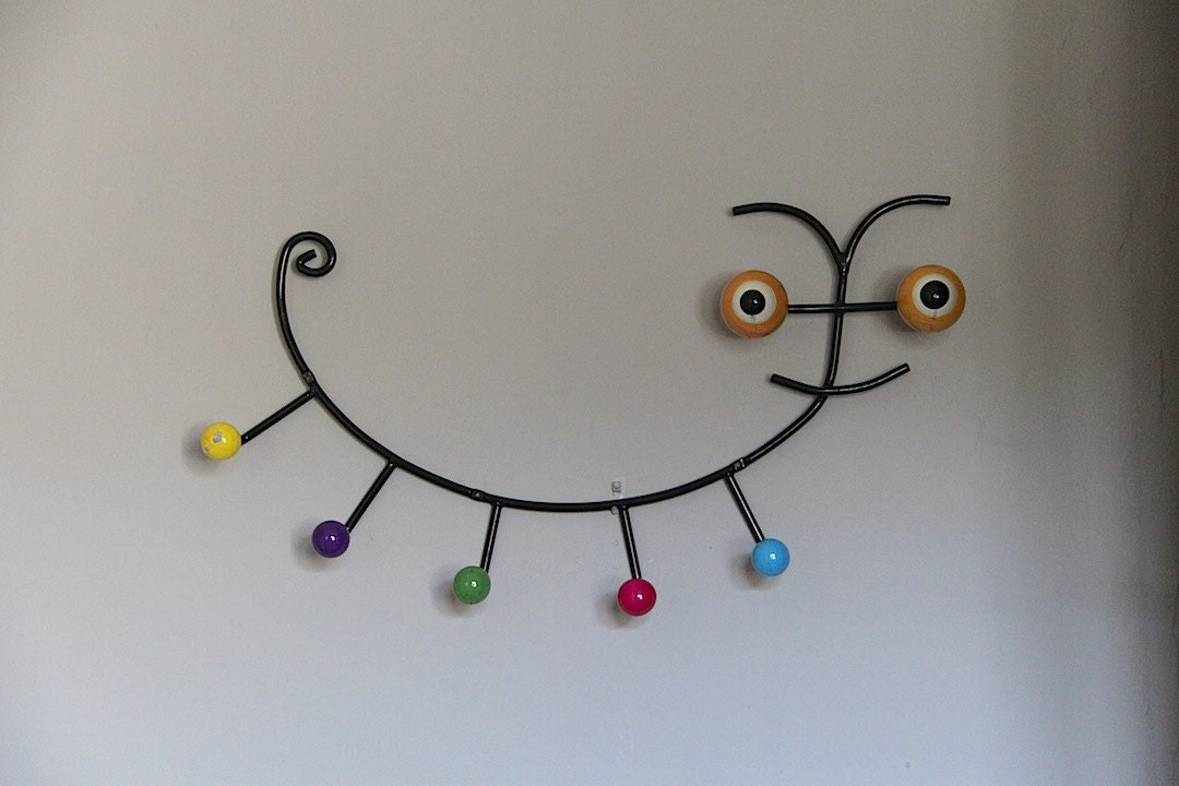 large funky atomic coat hook hat rack in the shape of a