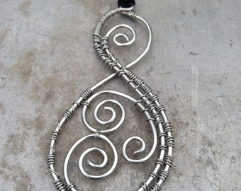 Traditional Maori Pikoura Pendant in Recycled Sterling Silver meaning the bond between us, connection, family