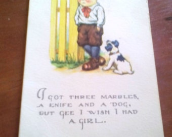 Vintage linen postcard boy and dog and marbles