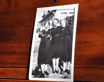 Vintage photograph of three smiling ladies, circa 1940's