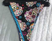 Black sugar skull bunting with red spotted back and black bias trim. Rockabilly, tattoo culture, goth, emo