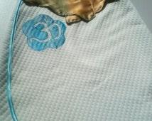 lightweight baby sleeping bag in a flower pattern aum 0/6months