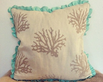 Beach Coral Pillow in Cream and Beige. Ribbon trim