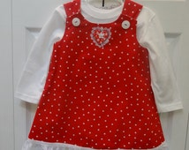 DESIGNER SET,Toddler's, red, dress and white polo shirt set,size 2 to 3  and white polka dots,fully lined ,white embroided, ruffle hemline.