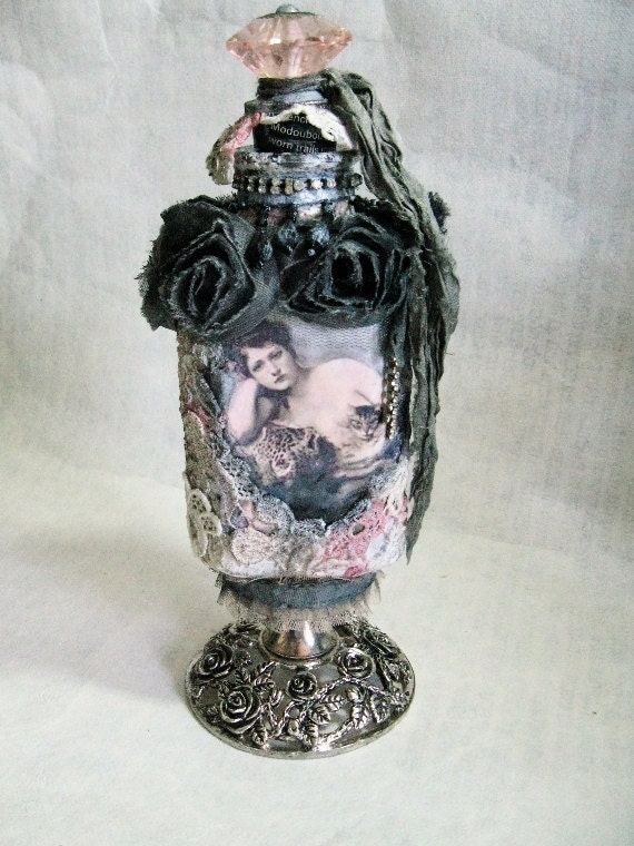 BOUDOIR altered embellished art bottle, rhinestones and lace, pink glass stopper, vintage metal base with roses 10 inches tall