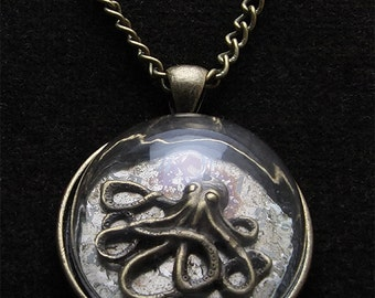 Medallion Octopus under glass and old watch with chain