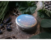 and stardust for phoebe -  solid perfume compact w/silvertone star spangled design and large opalite cabochon -over 60 natural aromas