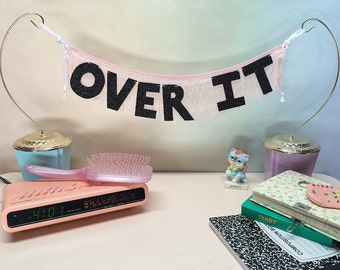 Over It Glittering Fringe Banner | wall hanging, letter banner, dorm decor, affirmation banner, party banner, whatever banner, go away