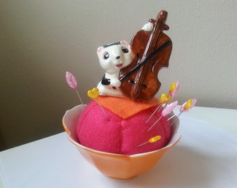 Skunk playing upright Bass pincushion