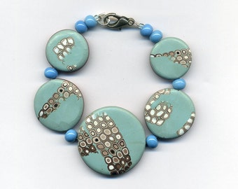 Polymer clay bracelet with glass beads