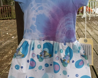 Blue, purple and aqua Picasso triggerfish onesie toddler dress