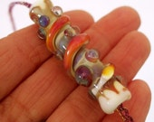 RESERVED Lampwork Focal Tube Bead on Handwoven Wire Necklace -  Gorgeous – Majik