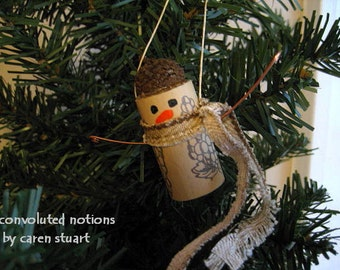 handmade wine cork snowman Christmas ornament seasonal decoration with acorn cap copper arms and fabric scarf