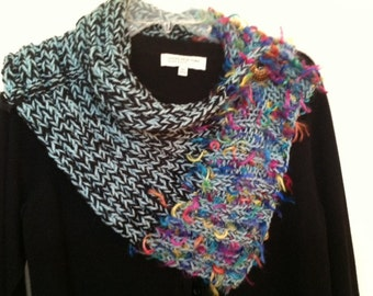 Versatile cowl in blue, black and hot pink with fringy yarn