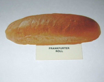 Vintage 1970s Food or Nutrition Die Cut Cardboard School Decoration of a Frankfurter Roll