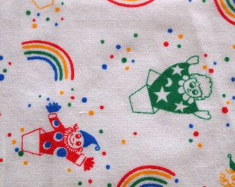 vintage 80s juvenile novelty fabric, featuring super cute jack-in-the-box clowns and rainbows design, 1 yard, 28 inches