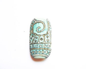 SILVERED COPPER TRIBE     copper green and silvered ivory matte finish squeezed focal   A Beaded Gift