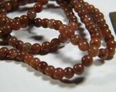 Gemstone beads: 16 inch strand natural brick red Aventurine, 4mm round, supplies