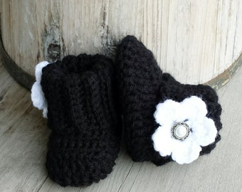 Crochet baby girl boots, in black with white flower and pearl button center. size 0 to 3 mo.