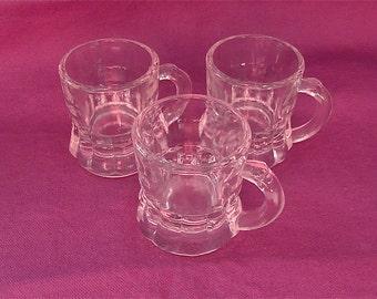 "Three Vintage ""Mug""  Shot Glasses"
