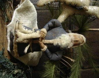 Primitive Folk Art Santa with Skates Ornament