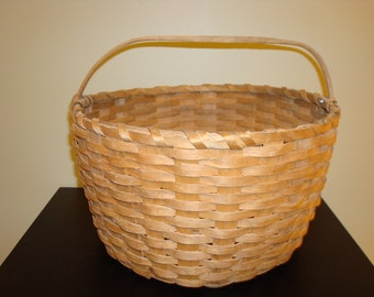 Vintage round ash carrying basket with carved wooden handle
