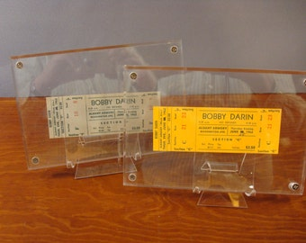 Two vintage unused Bobby Darin concert tickets under plexiglass for one price