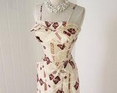 vintage 1950's dress ...unworn TIKI SPORTSWEAR polished cotton lei print petal bust hawaiian bombshell sarong dress