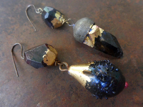 The Blackest Night. Asymmetric assemblage earrings with garnet quartz onyx gold leaf.
