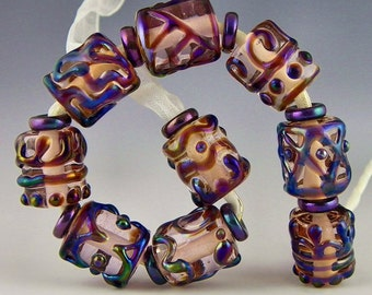 set of 9 purple iridescent on transparent pink handmade lampwork glass beads short tubes or barrels - Purple Iris