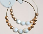 Czech glass beaded hoops.  Matte gold and pale blue color block earrings.