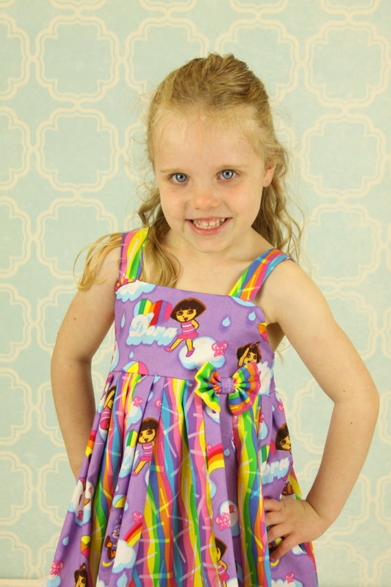 custom boutique dress made with Dora fabric size 2-6