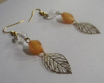 Gold Tone leaf earrings with orange and white beads