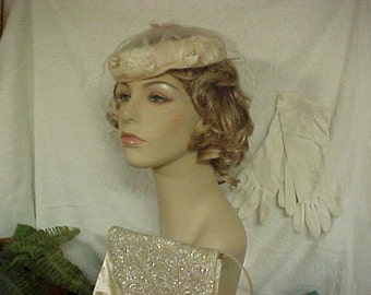 50 s pale pink fascinator hat with hat pin- face veil-  satin purse- and pair of white  gloves