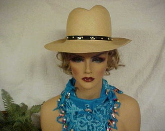 Western style straw fedora with a leather like band with studs